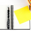 Pencil on open note book. Colorful paper notes — Stock Photo #14524993
