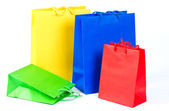 Sale shopping bags red, blue, yellow, green — Stock Photo