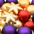 Stock Photo: Closeup of lila, red and golden baubles