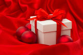 White gift box with christmas balls decoration — Stock Photo