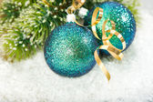 Christmas baubles with christmas tree branch — Stock Photo