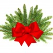 Branch of christmas tree with red ribbon bow - Stock Photo