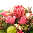 Fresh pink roses with golden christmas baubles — Stock Photo