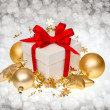 Stock Photo: White gift box over dark blurred background