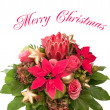 Fresh flowers with golden christmas baubles — Stock Photo