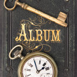 Vintage album with ild key and clock - Stockfoto