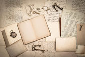 Open book, antique accessories, old letters — Stock Photo