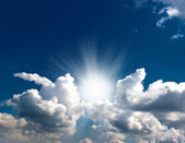 Dramatic blue sky with clouds and sun rays — Stock Photo