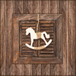 Christmas decoration rocking horse on wood — Stock Photo