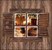 Wooden wall with window and christmas decoration — Stock Photo