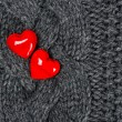 Red hearts over knitted wool background. Valentine's Day — Stock Photo