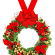 Christmas wreath with poinsettia and red ribbon bow — Stock Photo