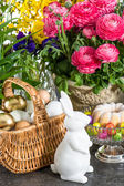 Spring flowers with easter eggs and bunny — Stock Photo
