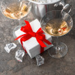 Two glasses, bottle of champagne and gift box — Stock Photo