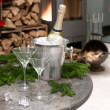 Festive home decoration with champagne and fireplace - Stock Photo