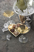 Two glasses, bottle of champagne and chocolate. Valentines Day — Stock Photo