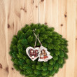 Traditional christmas wreath on wooden background — Stock Photo