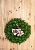 Traditional christmas wreath on wooden background — Photo