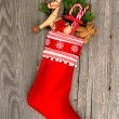 Christmas stocking with nostalgic vintage toy decoration — Stock Photo