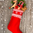 Stock Photo: Christmas stocking with nostalgic toys and snowflakes