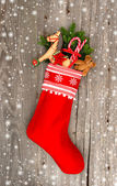 Christmas stocking with nostalgic toys and snowflakes — Stock Photo