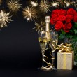 Bottle of champagne with golden fireworks on black — Stock Photo #17592419
