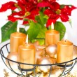Burning golden candles and red christmas flower — 图库照片