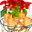 Burning golden candles and red christmas flower — Stock Photo #17592549