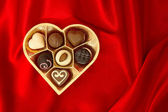 Chocolate pralines in golden heart shape box. Valentine's Day — Stock Photo