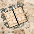 Antique family album over nostalgic vintage background — Stock Photo