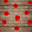 Red rose petals on wooden background — Stock Photo #18076687