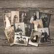 Vintage family photos on wooden background - Stock Photo