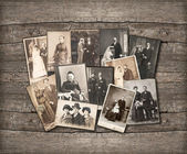 Vintage family photos on wooden background — Stock Photo