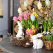 Spring flowers with easter eggs decoration — Stock Photo #18082773