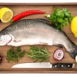 Raw salmon trout fish on wooden background — Stock Photo #18107033