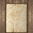 Old paper sheet over rustic wooden background — Stock Photo