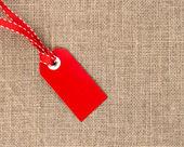 黄麻布のリボンと赤ラベル — ストック写真