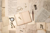 Open book, vintage accessories, old letters — Stock Photo