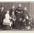 Old family photo. parents with five children - Stock Photo