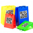 Colorful shopping bags with QR code — Stock Photo