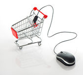 Internet online shopping concept. computer mouse and cart — Stock Photo