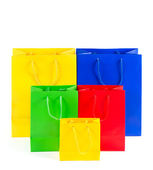 Assorted multicolored shopping bags on white — Stock Photo