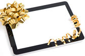 Tablet pc golden bow and ribbon decoration — Stock Photo