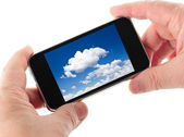 Blue sky with white clouds picture on smart communicator display — Stock Photo