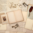 Open book, old letters, post cards, glasses, keys, clock — Stock Photo #18560229