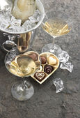 Two glasses, bottle of champagne and chocolate — Stock Photo