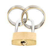 Wedding rings and key lock over white — Stock Photo