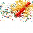Golden streamer, party cracker and confetti — Stock Photo #18636077