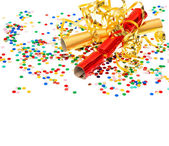 Golden streamer, party cracker and confetti — Stock Photo