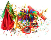 Garlands, streamer, cracker, party glasses and confetti — Stock Photo